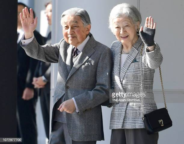 Emperor Akihito and Empress Michiko wave to wellwishers on arrival at JR Kakegawa Station on November 27 2018 in Kakegawa Shizuoka Japan