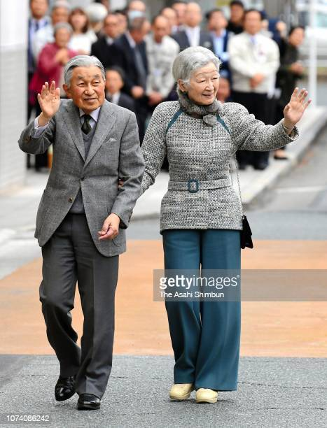 Emperor Akihito and Empress Michiko wave to wellwishers on arrival at JR Hamamatsu Station on November 28 2018 in Hamamatsu Shizuoka Japan