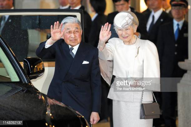 Emperor Akihito and Empress Michiko wave to well-wishers on arrival at Uji Yamada Station on April 17, 2019 in Ise, Mie, Japan. The emperor will...