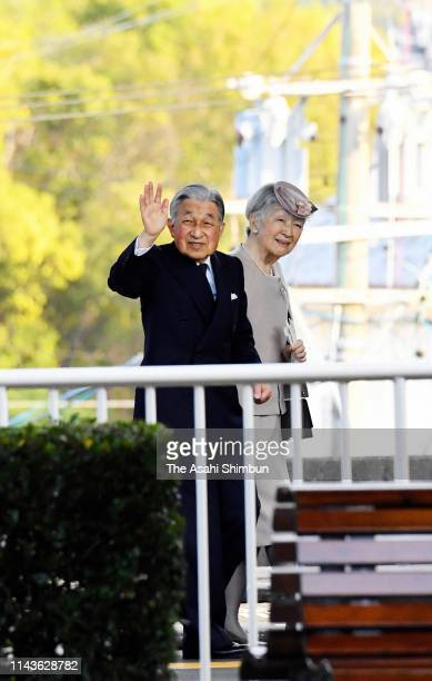 Emperor Akihito and Empress Michiko wave to well-wishers on arrival at Kashikojima Station after visiting the Ise Shrine on April 18, 2019 in Shima,...