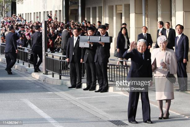 Emperor Akihito and Empress Michiko wave to well-wishers on arrival at Uji Yamada Station after visiting the Ise Shrine on April 18, 2019 in Ise,...