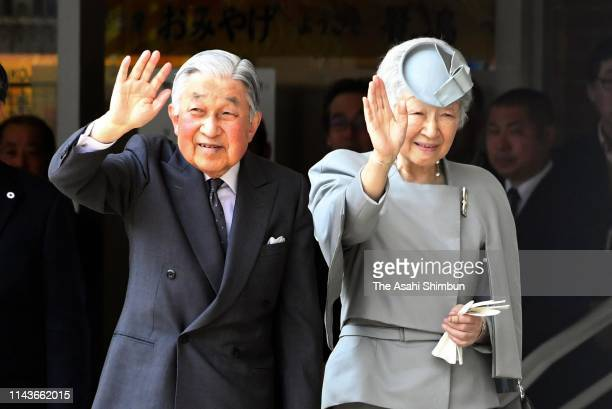 Emperor Akihito and Empress Michiko wave to wellwishers on arrival at Kashikojima Station on April 19 2019 in Shima Mie Japan The emperor will...