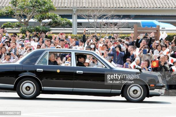 Emperor Akihito and Empress Michiko wave to well-wishers on arrival at Kashikojima Station on April 19, 2019 in Shima, Mie, Japan. The emperor will...
