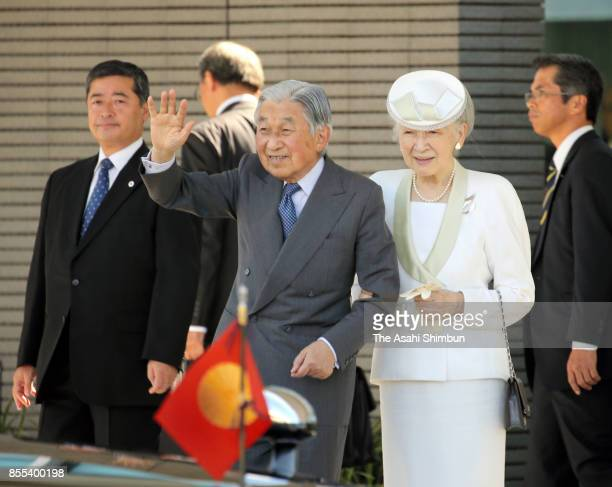 Emperor Akihito and Empress Michiko wave to wellwishers on arrival at Matsuyama Airport on September 29 2017 in Matsuyama Ehime Japan