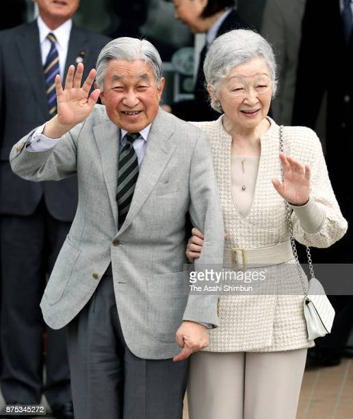 Emperor Akihito and Empress Michiko wave to wellwishers on arrival at Yoron airport during their visit to Yoronjima Island on November 17 2017 in...