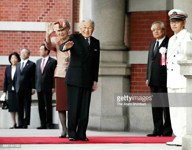 Emperor Akihito and Empress Michiko wave to wellwishers on arrival at the Tokyo Station Hotel to attend the renovation completion ceremony of the...
