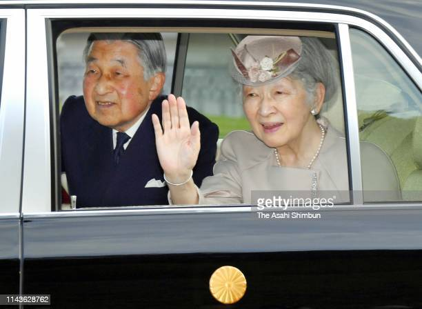 Emperor Akihito and Empress Michiko wave to well-wishers on departure at Kashikojima Station after visiting the Ise Shrine on April 18, 2019 in...