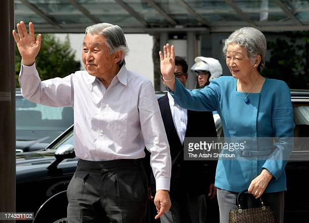 Emperor Akihito and Empress Michiko wave to well-wishers on departure at JR Fukushima Station on July 23, 2013 in Fukushima, Japan. The Emperor and...