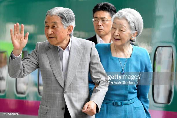 Emperor Akihito and Empress Michiko wave to wellwishers on departure for the Nasu Imperial Villa at Tokyo Station on July 24 2017 in Tokyo Japan