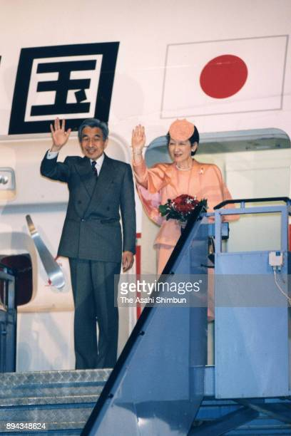 Emperor Akihito and Empress Michiko wave to wellwishers on departure at Munich Airport on September 18 1993 in Munich Germany