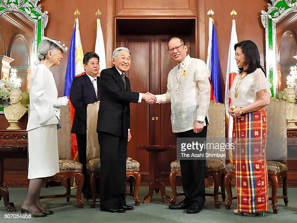 Emperor Akihito and Filipino President Benigno Aquino shake hands while Empress Michiko and Aurora Corazon AquinoAbellada watch during their meeting...