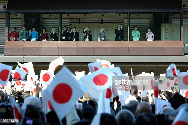 Emperor Akihito and other members of the Japanese Imperial Family wave to the wellwishers celebrating the New Year at the Imperial Palace on January...