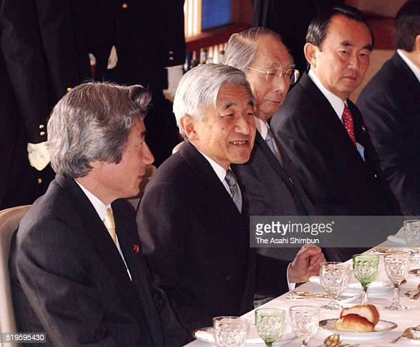 Emperor Akihito and Prime Minister Junichiro Koizumi talk during the luncheon at the Imperial Palace on December 20 2002 in Tokyo Japan