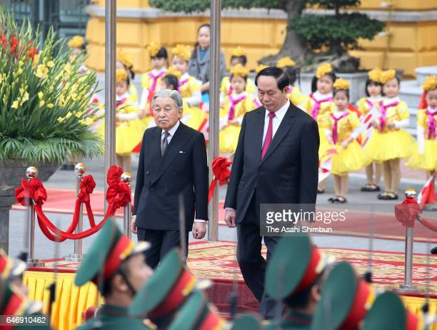 Emperor Akihito and Vietnamese President Tran Dai Quang attend the welcome ceremony at the presidential palace during day two of their visit to...