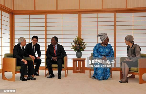 Emperor Akihito and Zambian President Michael Chilufya Sata speak while Empress Michiko and Sata's wife Christine Kaseba at the Imperial Palace on...