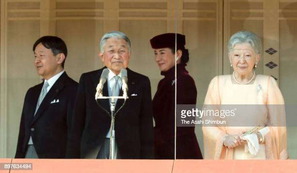 Emperor Akihito arrives at the balcony with Empress Michiko Crown Prince Naruhito and Crown Princess Masako to greet wellwishers as he turns 84 at...
