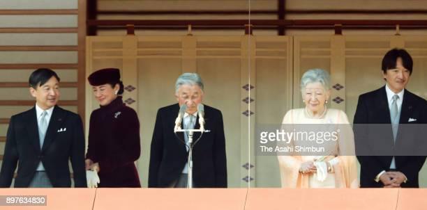 Emperor Akihito arrives at the balcony with Empress Michiko Crown Prince Naruhito Crown Princess Masako and Prince Akishino to greet wellwishers as...