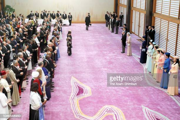 Emperor Akihito attends the 'Chakai-no-Gi' tea party celebrating his 85th birthday with Empress Michiko, Crown Prince Naruhito, Prince Akishino,...