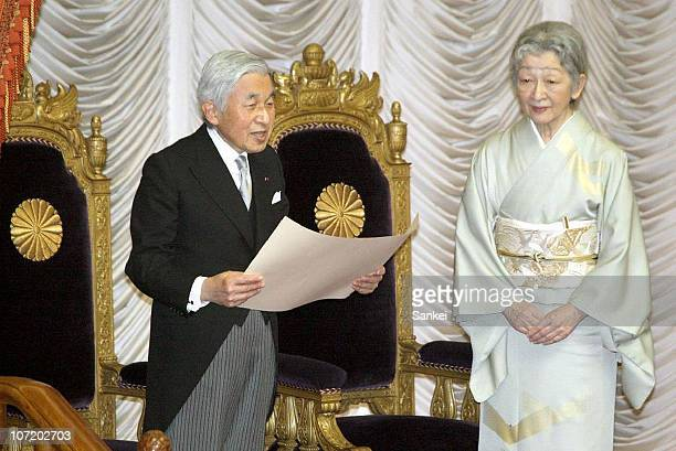 Emperor Akihito delivers a speech while Empress Michiko listens during the ceremony to celebrates 120th anniversary of Japanese parliament launch at...