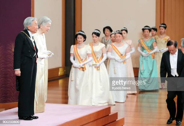 Emperor Akihito Empress Michiko and other members of Japan's imperial family attend a New Year's ceremony at the Imperial Palace in Tokyo on Jan 1...