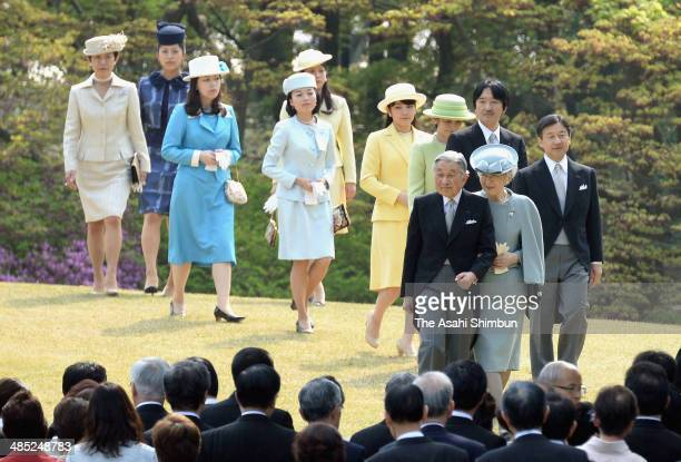 Emperor AKihito Empress Michiko and royal family members walk toward the guest during the spring garden party at Akasaka Palace on April 17 2014 in...