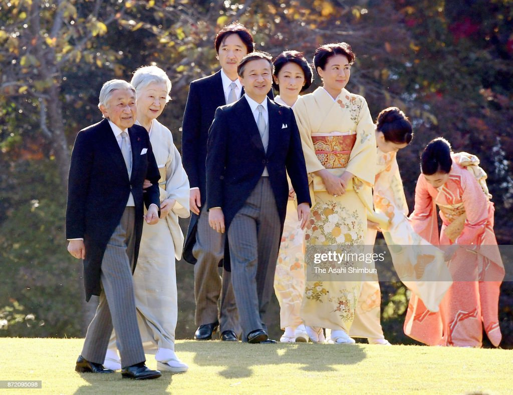 Emperor Akihito, Empress Michiko and royal family members walk toward guests during the Autumn Garden Party at the Akasaka Imperial Garden on November 9, 2017 in Tokyo, Japan.
