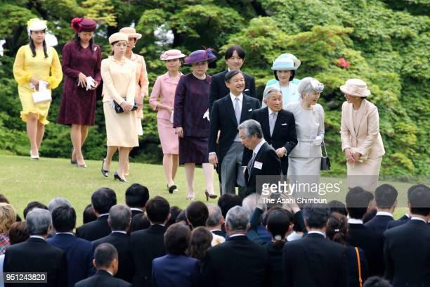Emperor Akihito, Empress Michiko and royal family members walk toward guests during the spring garden party at the Akasaka Imperial Garden on April...