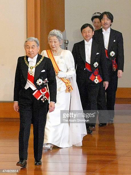 Emperor Akihito Empress Michiko Crown Prince Naruhito and Prince Akishino enter the room during the 'ShinnenShukuganoGi' ceremony to celebrate the...