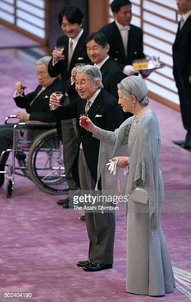 Emperor Akihito, Empress Michiko, Crown Prince Naruhito, Prince Akishino and Prince Hitachi toast glasses during the tea party celebrating the...