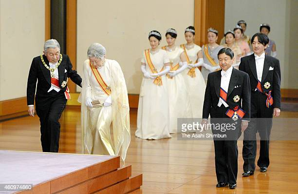 Emperor Akihito escorts Empress Michiko to the stage while Crown Prince Naruhito Prince Akishino and other royal members enter the room during the...