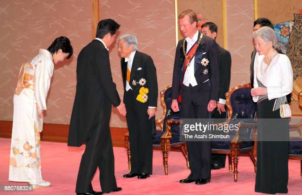 Emperor Akihito Grand Duke Henri of Luxembourg and Empress Michiko greet Prime Minister Shinzo Abe and his wife Akie prior to the state dinner at the...