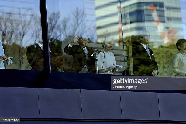 Emperor Akihito greets the thousands of people at the balcony of the Imperial Palace which was opened for the New Year's public appearance by the...