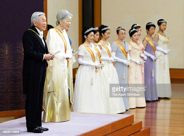 Emperor Akihito greets while Empress Michiko and other royal members listen during the 'ShinnenShukuganoGi' ceremony to celebrate the New Year at the...
