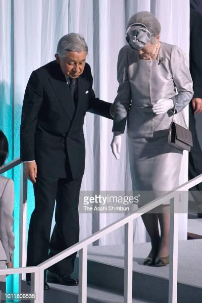 Emperor Akihito helps Empress Michiko after attending the Hokkaido 150th anniversary ceremony at Hokkai Kitayell on August 5, 2018 in Sapporo,...