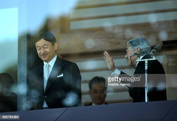 Emperor Akihito in presence of Crown Prince Naruhito and Japan's Royal Family waves and wishes happiness and peace to thousands of people came to...
