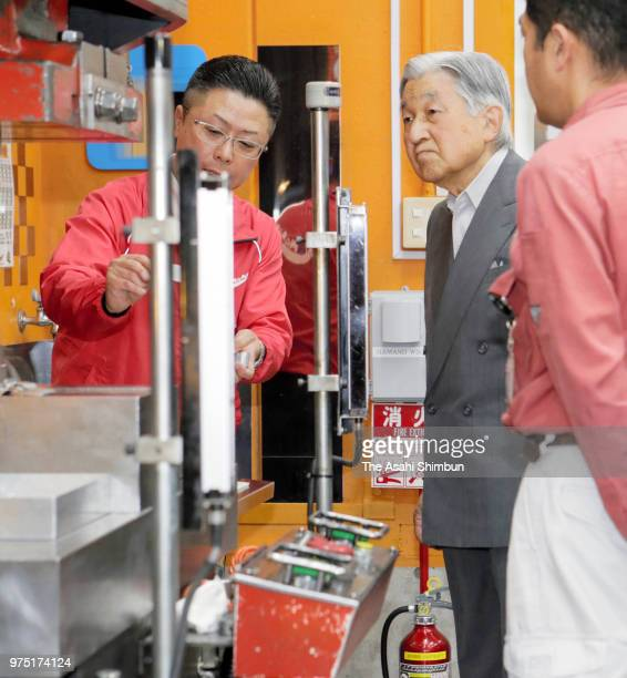 Emperor Akihito waves to wellwishers as he inspects a factory on June 15 2018 in Tokyo Japan