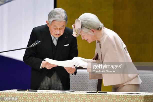 Emperor Akihito is assisted by Empress Michiko during his addresses at the ceremony marking the 30th anniversary of the enthronement at the National...