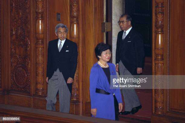 Emperor Akihito is escorted by Lower House Speaker Takako Doi prior to the opening ceremony of the 127th special session of the diet at the Upper...