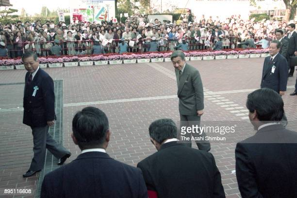 Emperor Akihito is seen on arrival at the Marugame City Gymnasium to watch volleyball competition on October 26 1993 in Marugame Kagawa Japan