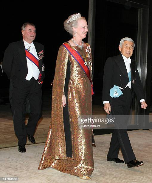 Emperor Akihito leads Queen Margrethe II and Prince Consort Henrik upon their arrival at the Imperial Palace for a formal banquet on November 16 2004...