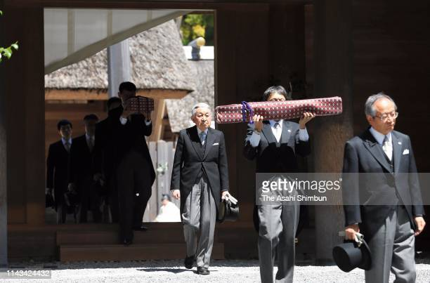 Emperor Akihito leaves the Geku, outer shrine with chamberlains holding a legendary sword and a jewel at Ise Shrine on April 18, 2019 in Ise, Mie,...