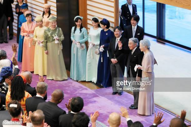 Emperor Akihito leaves the room with Empress Michiko after the 'ChakainoGi' tea party on his 85th birthday at the Imperial Palace on December 23 2018...
