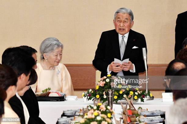 Emperor Akihito makes a speech while Empress Michiko listens during a banquet celebrating his 84th birthday at the Imperial Palace on December 23...