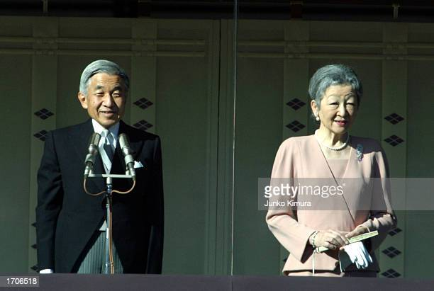 Emperor Akihito of Japan and Empress Michiko greet a crowd during celebrations for the New Year on January 2 2003 in Tokyo Japan