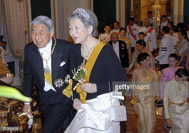 Emperor Akihito of Japan and Empress Michiko of Japan attend the Royal banquet at the Golden Palace on June 13, 2006 in Bangkok. The king of Thailand...