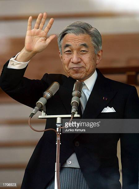 Emperor Akihito of Japan greets the crowd assembled outside the Imperial Palace during celebrations for the New Year on January 2 2003 in Tokyo Japan