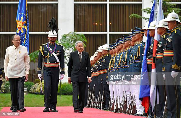 Emperor Akihito reviews the honour guard during a welcoming ceremony alongside Filipino President Benigno Aquino at the Malacanang Palace on January...