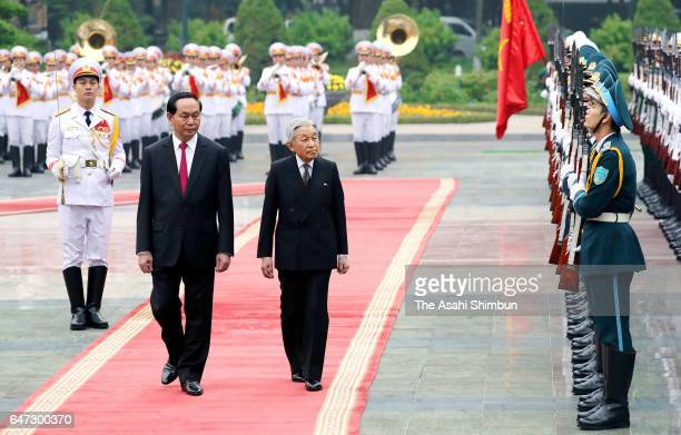 Emperor Akihito reviews the honour guard with Vietnamese President Tran Dai Quang during the welcome ceremony at the presidential palace during day...