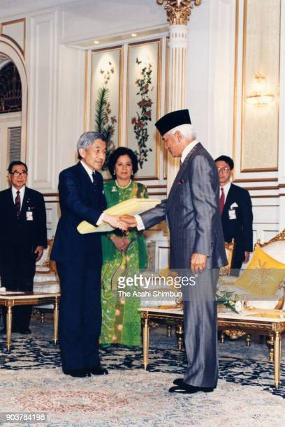 Emperor Akihito shakes hands with Sultan Azlan Shah of Malaysia prior to their meeting at the Istana Negara on September 30 1991 in Kuala Lumpur...