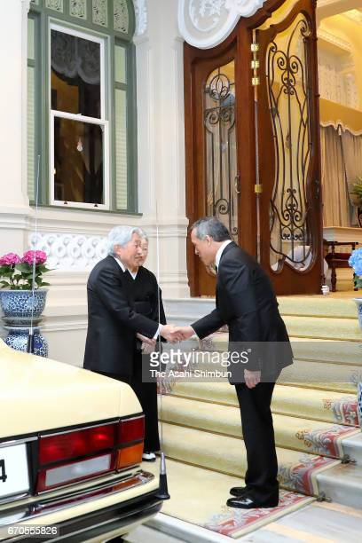 Emperor Akihito shakes hands with Thai King Maha Vajiralongkorn after paying their respects to the late King Bhumibol Adulyadej at the Grand Palace...